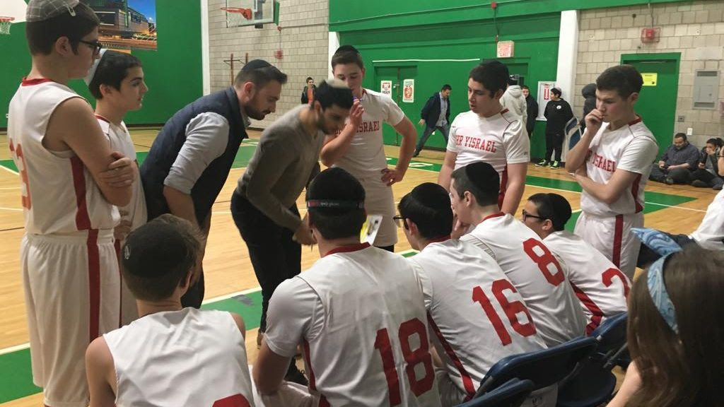 Basketball team huddle during a game